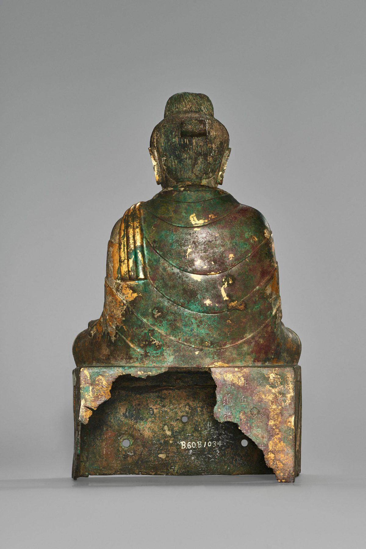 Back of a golden Buddha statue.