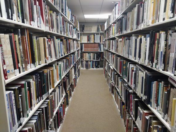 Library shelves full of books.