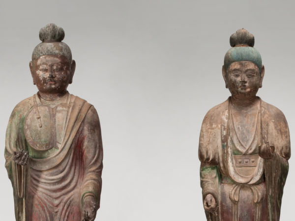 Two standing temple guardian statues